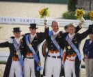 The Dutch team pictured on the podium after becoming World Dressage Champions for the first time at the Alltech FEI World Equestrian Games™ in Kentucky, USA. Left to right – Adelinde Cornelissen (Jerich Parzival), Imke Schellekens-Bartels (Hunter Douglas Sunrise), Hans Peter Minderhound (Exquis Nadine) and Edward Gal (Moorlands Totilas). Photo by: FEI/Dirk Caremans