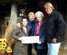 Robin Goodman of the Make-a-Wish Foundation received a cheque for $9,000 from event organizers Lynda Beard, Norma Humphrey and Gary Boumeister