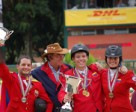 L to R – Venezuela's Juan Andres Larrazabal (silver), Chef D'Equipe Juan Andres Sauce, Martin Jeri (gold) and Ariana Velutini (bronze) celebrate their success in the Young Riders competition at the Americas Jumping Championships in Caracas, Venezuela