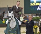Kevin Staut from France, riding Silvana de Hus, accepts a Rolex watch from Mr Jean-Noel Bioull of Rolex as winner of today's sixth leg of the 2010/2011 Rolex FEI World Cup™ Jumping series in Geneva, Switzerland. Photo by Kit Houghton