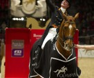 The Netherlands' Adellinde Cornelissen celebrates her second successive win in the 2010/2011 Reem Acra FEI World Cup™ Dressage series with Jerich Parzival at Olympia in London. Photo by Kit Houghton/FEI