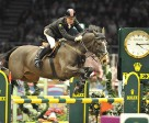 Great Britain's Michael Whitaker produced a sensational round against the clock with GIG Amai to win the seventh leg of the 2010/2011 Rolex FEI World Cup™ Jumping series at Olympia in London today. Photo by Kit Houghton/FEI