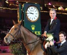 Winner of the 11th leg of the Rolex FEI World Cup™ Jumping series in Vigo, Spain, Michael Robert (FRA), receives his Rolex watch from Anthony Schaub, Rolex SA. Photo by Paco Rey/FEI