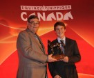 Equine Canada president, Michael Gallagher and Ben Asselin, the 2010 Junior Equestrian of the year. Photo by Betty Cooper