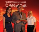 The 2010 Canadian Eventing Team for the World Equestrian Games was awarded the Doctor George Jacobsen Trophy (l-r) Stephanie Rhodes-Bosch; Equine Canada president, Michael Gallagher; and Hawley Bennett-Awad. Photo by Betty Cooper