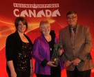 Jan Stephens was presented with the 2010 Equine Canada Volunteer of the Year by Sara Runnalls of BFL Canada, and Equine Canada president, Michael Gallagher. Photo by Betty Cooper