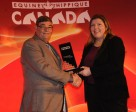 Jackie VandenBrink accepted the Equine Canada Sponsor of the Year Award, from Equine Canada president Michael Gallagher, on behalf of Masterfeeds. Photo by Betty Cooper