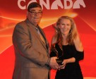 Michael Gallagher, Equine Canada president, and Cealy Tetley, recipient of the 2010 Susan Jane Anstey Media Award. Photo Betty Cooper