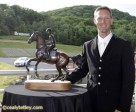 Clark Montgomery holds the Todd Sandler Challenge trophy after winning the CCI3* Bromont Three Day Event on June 12 in Bromont, Quebec. Photo by Cealy Tetley, www.tetleyphoto.com