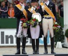 On the podium after the Grand Prix Freestyle which brought the FEI European Dressage Championships 2011 to a close in Rotterdam (NED) today: L to R - silver medallist Carl Hester (GBR), gold medallist Adelinde Cornelissen (NED) and bronze medallist Patrik Kittel (SWE). Photo by FEI/Peter Nixon.
