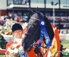 Beth Underhill and Monopoly winning the 1994 Canadian Show Jumping Championships at Spruce Meadows. Photo by Clix