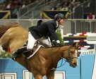 Attached Photo:  McLain Ward of Brewster, NY, takes this CN Tower wall jump on a severe angle to save time in tonight's $50,000 Weston Canadian Open at the 89th Royal Horse Show in Toronto. Photo by mdunnphoto.com