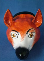 This Staffordshire pottery fox head stirrup cup dates to the Edwardian Era. Circa 1910.