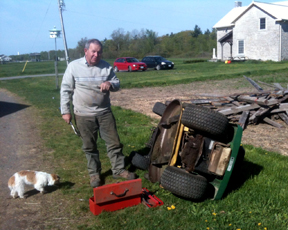 Our neighbor Charlie Foreman gives us the bad news on the lawn tractor.