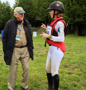 Selena goes over her ride on 'Woody' with owner John Rumble, who is himself an Olympic bronze medalist in Three Day Eventing.