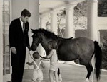 Macaroni the Pony at the White House steps with President Kennedy, Caroline and John.