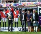 Team USA won their third consecutive Furusiyya FEI Nations Cup™ Jumping competition at the last leg of the Europe Division 1 2014 series in Dublin, Ireland. Pictured (L to R): Matt Dempsey, President of the Royal Dublin Society: His Excellency the President Of Ireland Micheal D Higgins: Katie Dinan, Jessica Springsteen, Charlie Jayne, Chef d'Equipe Robert Ridland and Beezie Madden from Team USA; Saudi Arabian Ambassador to Ireland His Excellency Abdul Aziz Abdul Rahman Aldriss: Katrina Jones, Brand Director Longines UK and Ireland: and John McEwen, FEI First Vice-President. Photo by FEI/Tony Parkes