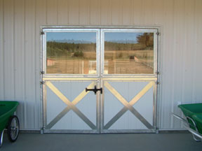 Elegant looking double dutch doors, with large windows on the top half.