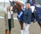 Liz Prest of KBIS Insurance and her daughter, Emma Prest, present Roberta Sheffield and Double Agent with the first place ribbon for winning Grade III test at the KBIS Para Dressage Championship at the Le Mieux National Dressage Championships 2014.