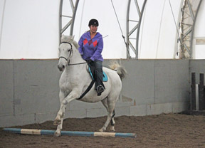 Luc and I finally get the hang of cantering the circle of poles.