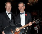 FEI Group IV Chairman Mark Samuel placed the winning bid on the Canadian-made Norman guitar auctioned off by keynote speaker, Canadian astronaut Commander Chris Hadfield, to benefit C-DAAP. Photo by One Shot George