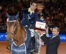 Colombia's Carlos Lopez, winner of the sixth leg of the Longines FEI World Cup™ Jumping 2014/2015 Western European League in Madrid, Spain today, pictured with his winning horse, Prince de la Mare, and Longines Brand Manager for Spain, Miguel Angel Palmer. Photo by FEI/Herve Bonnaud