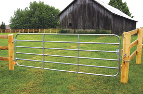 This galvanized steel gate is long enough to allow large equipment to enter the paddock.