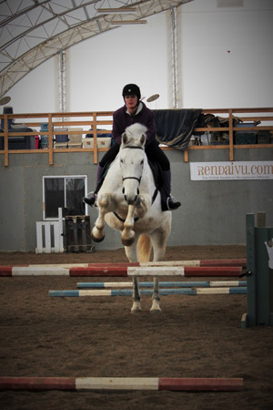 Luc and I soar over the tiny oxer.