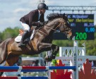 Mac McQuaker and Brother Thelonious on their way to victory in the $7,500 Lynn Millar Memorial Speed Derby at the Ottawa International Horse Show at Wesley Clover Parks. Photo by Ben Radvanyi Photography