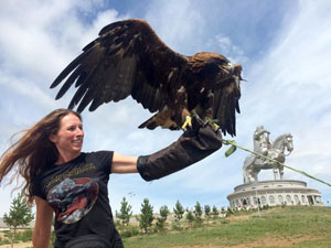 Playing with a golden eagle outside the Genghis Khan statue.