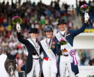 Pictured at the prize-giving for the Grand Prix Special at the FEI European Dressage Championships in Aachen, Germany: (L to R) silver medallist Kristina Bröring-Sprehe (GER), gold medallist Charlotte Dujardin (GBR) and bronze medallist Hans Peter Minderhoud (NED). Photo by FEI/Dirk Caremans
