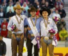 The individual medal podium at the FEI European Reining Championships (from left), silver medallist Grischa Ludwig (GER), gold medallist Giovanni Masi de Vargas (ITA), and bronze medallist Elias Ernst (GER). Photo by FEI/Dirk Caremans