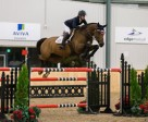 Amy Millar of Perth, ON, guided Heros to victory in the $35,000 CSI2* Caledon Cup – Phase Two in the new indoor arena at the Caledon Pan Am Equestrian Park on Friday night, September 25. Photo by Ben Radvanyi