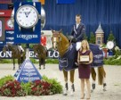 Harrie Smolders (NED) and Emerald (left), winners of the Longines FEI World Cup™ Jumping at the Washington International Horse Show, were presented with a Longines watch by Taylor Mace, National Event Manager for Longines. Photo by StockImageServices.com/FEI