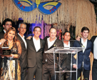 Juan Andres Rodriguez, Jessica Newman, Emanuel Andrade, Pablo Barrios, Alejandro Karolyi, Juan Ortiz, Victor Segovia, Luis Larrazabal, and Angel Karolyi on stage at the 13th Annual JustWorld Gala presented by Wellington Masters. Photo by Steven Michael King