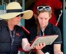 Mary Longden provides para-dressage athlete, Sarah Cummings, with video feedback during the 2015 North American Junior and Young Rider Championships (NAJYRC) in Kentucky, USA. Photo by Nathalie Lawson