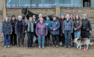Three pictures – group shot, targeting, working with horse afraid of clippers (the appy).