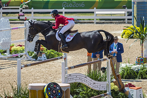 Tiffany Foster and Triple X III finish three rounds with eight faults and qualify for the individual final.