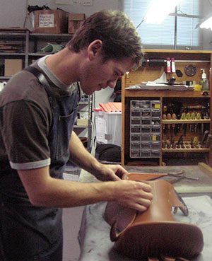 Chris Moloughney shown here setting 'skirts' on a 'blocked' saddle seat during his apprenticeship.
