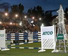 Chris Surbey and Arezzo clear 1.90m in the ATCO Six Bar competition at the Spruce Meadows Masters. Photo by Spruce Meadows Media Services