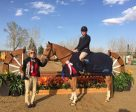 Cornelle and Rodney Tulloch accepting their first red ribbon of the 2016 series at the $4,000 Canadian Hunter Derby at the RMSJ Bow Valley Classic II in May.