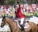 Eric Lamaze celebrates with the Canadians fans after winning the 2016 Olympic individual bronze medal. He has now won gold, silver and bronze medals for his country, making him the most successful equestrian athlete in Canadian Olympic history.  Photo by Arnd Bronkhorst Photography