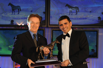 Eurico Rosa Da Silva accepts the Sovereign Award for 2010 Outstanding Jockey from Hall of Fame Jockey, Sandy Hawley (left). Photo by Michael Burns