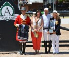 Carlene Ziegler of Artisan Farms receives with the Champion Equine Insurance Overall Jumper Style Award, presented by Laura Fetterman, on behalf of Zigali P S. From left to right: Ringmaster Gustavo Murcia, Carlene Ziegler, Eric Lamaze and Laura Fetterman. Photo by Starting Gate Communications Inc.