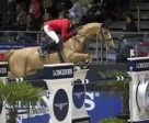Switzerland's Pius Schwizer steered Quidam du Vivier to victory in tonight's opening round of the Longines FEI World Cup™ Jumping 2013/2014 Final at Lyon, France. Photo by FEI/Dirk Caremans.