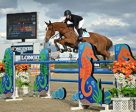 Ashlee Bond and Chela LS on their way to a $100,000 Longines FEI World Cup Qualifier win. Photo by ESI Photography