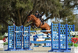 Isabelle Lapierre and Cesha M on their way to a $50,000 HITS Grand Prix win. Photo by ESI Photography