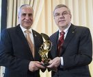 "International Olympic Committee President Thomas Bach (right) paid tribute to equestrian sport when presenting FEI President Ingmar De Vos with the IOC President's Trophy, a bronze entitled ""The Sky Is The Limit"" during the annual FEI Sports Forum 2017 in a ceremony attended by over 300 members of the global equestrian community. Photo by FEI/Richard Juilliart"